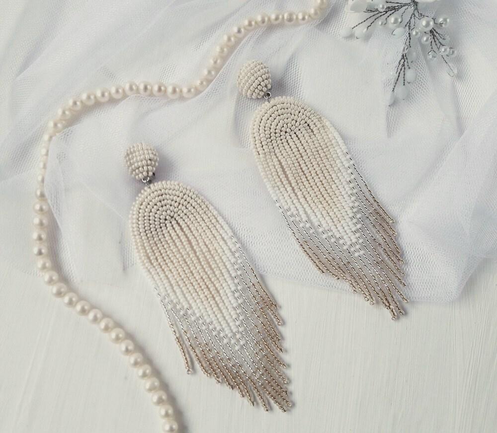 A pair of boho bridal statement earrings from Beaded Splendour on Etsy