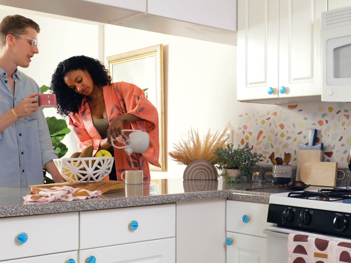 A bright sunny kitchen brimming with colorful Etsy accents