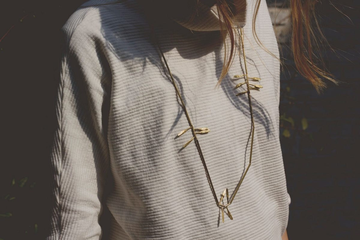 A delicate brass leaf necklace from Mai Solorzano