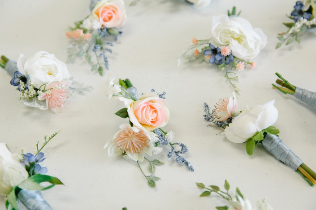 Pink and blue silk boutonnieres from The Faux Bouquets
