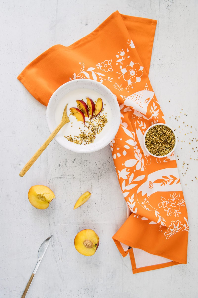 An orange woodland fox tea towel from Softer and Wild