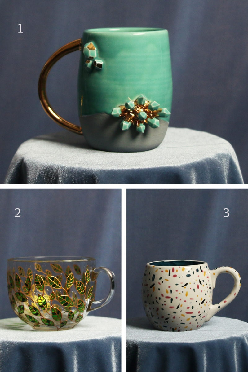 A collage of mugs for air signs, including a crystal-encrusted mug for Aquarius, a glass mug with a hand-painted leaf motif for Libra, and a colorful confetti mug for Gemini
