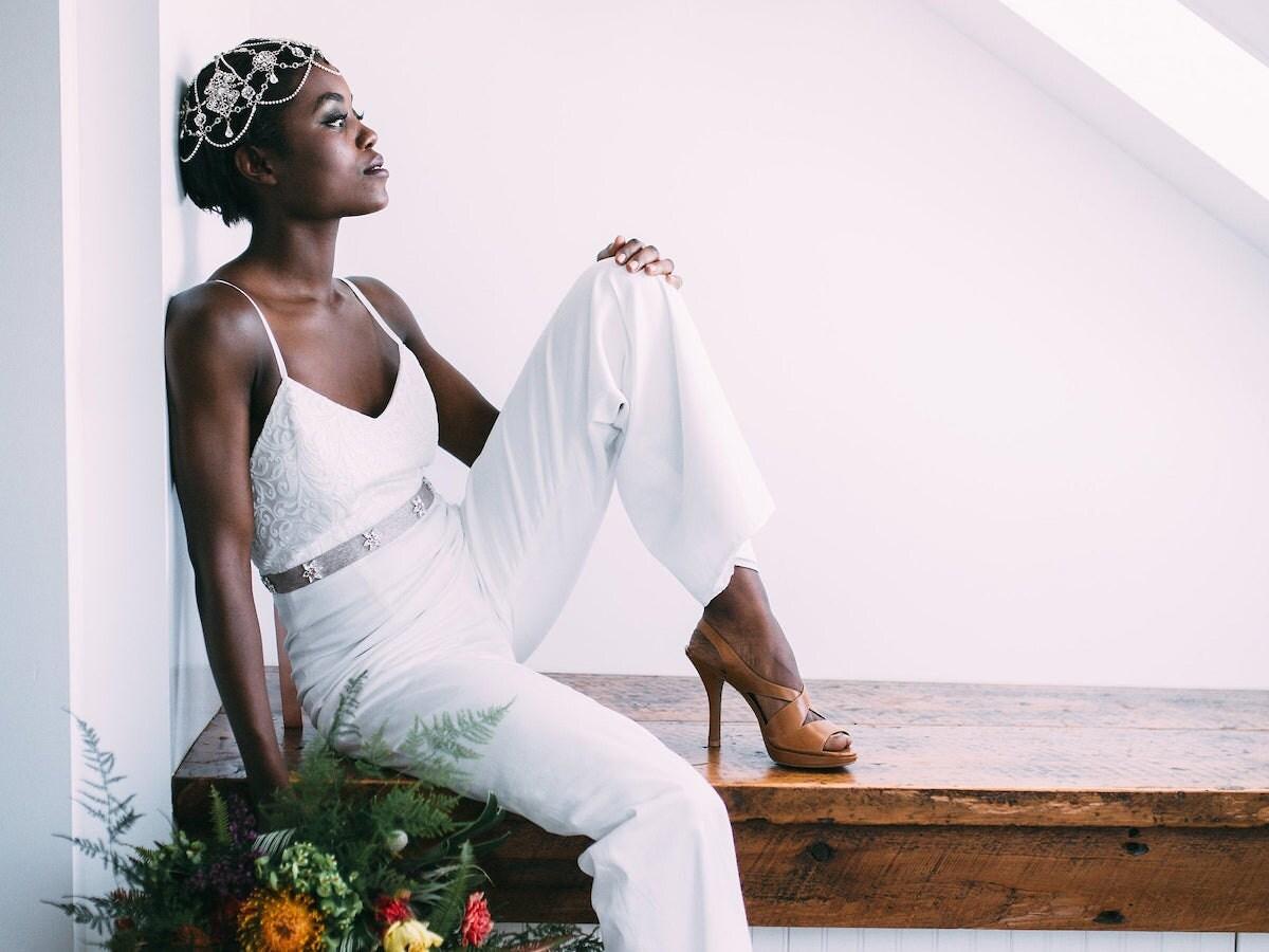 A woman models a bridal jumpsuit from Jordan de Ruiter
