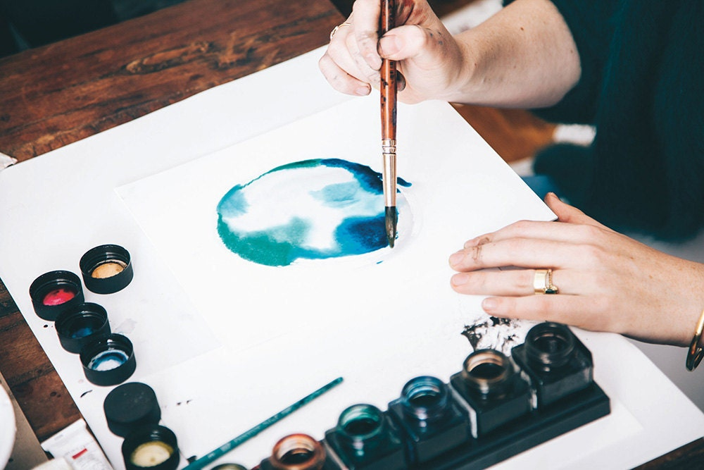 Using watercolor paints at a sip and paint night