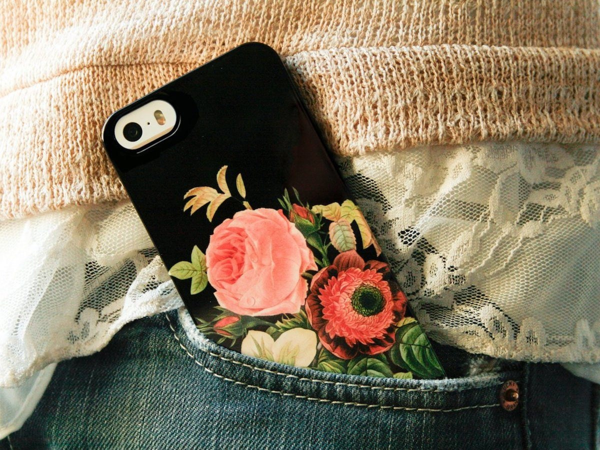 Colorful floral phone case from Joy Merryman peeking out of a pants pocket