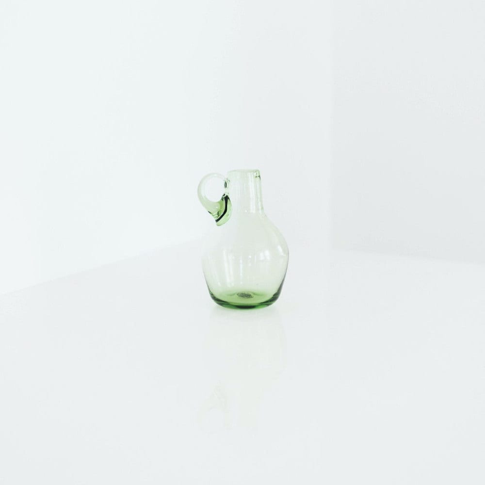 A vintage green blown glass pitcher from Otherwise Shoppe
