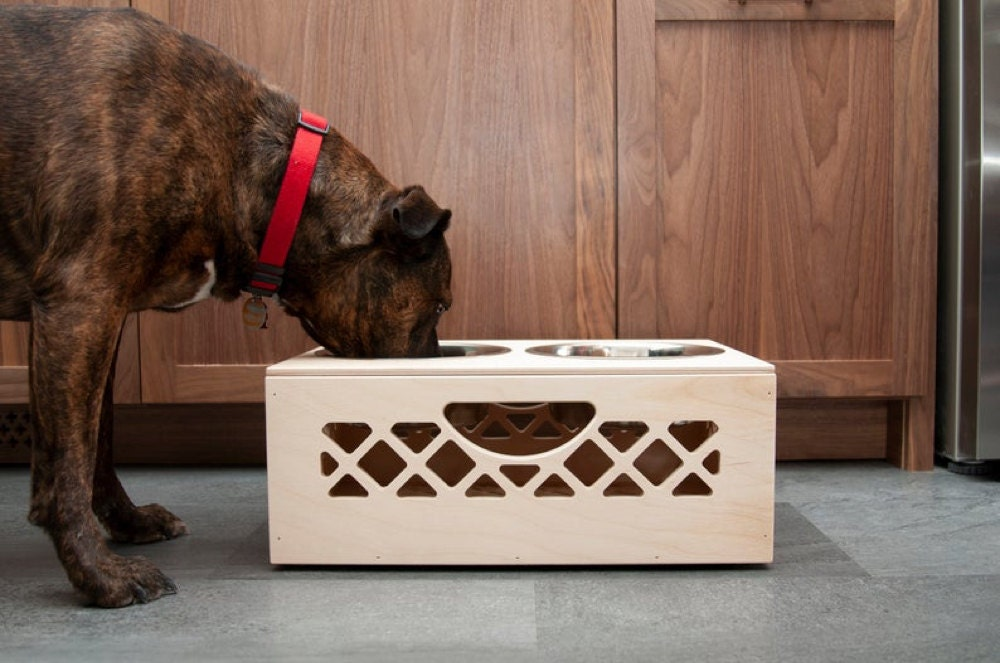A personalized dog bowl crate from WAAM Industries