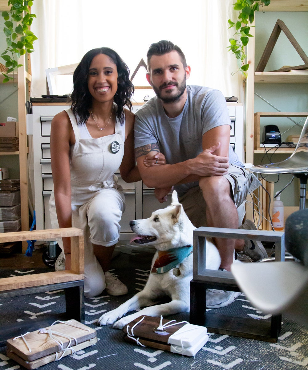 A portrait of TheCraftySwirl owner Ilana Mayes in the studio with her partner Mike and her dog Scout.