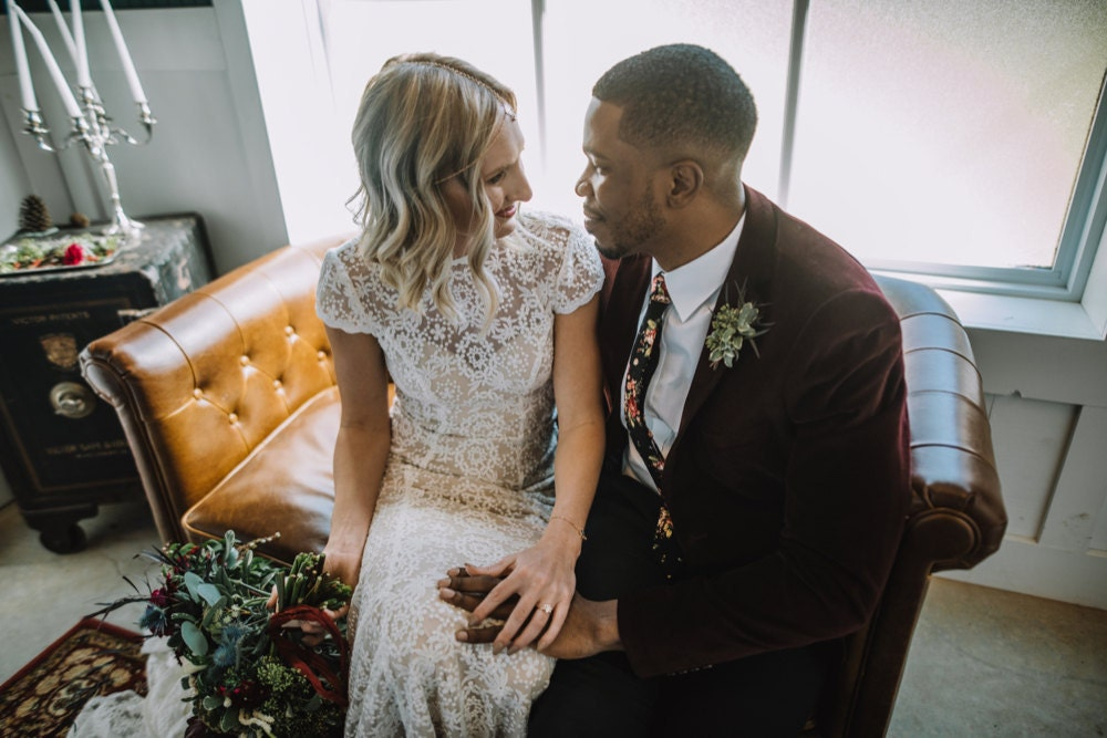 Emily and Terrell enjoy a private moment together away from guests