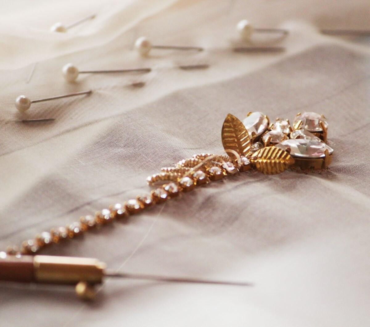 Details of a crystal bridal belt in progress