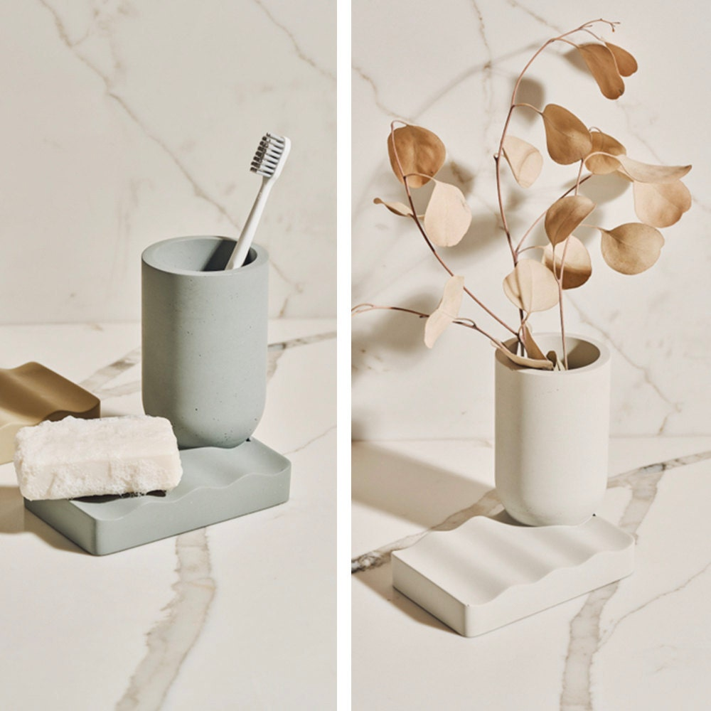 A versatile concrete vessel (displayed as both a vase and toothbrush holder) in multiple colorways, from the Tan France x Etsy collection