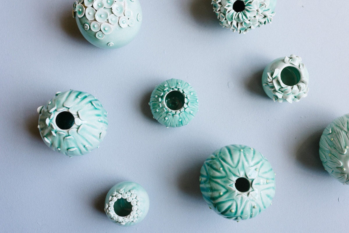 A collection of blue and green vases from Echo of Nature arranged on a surface