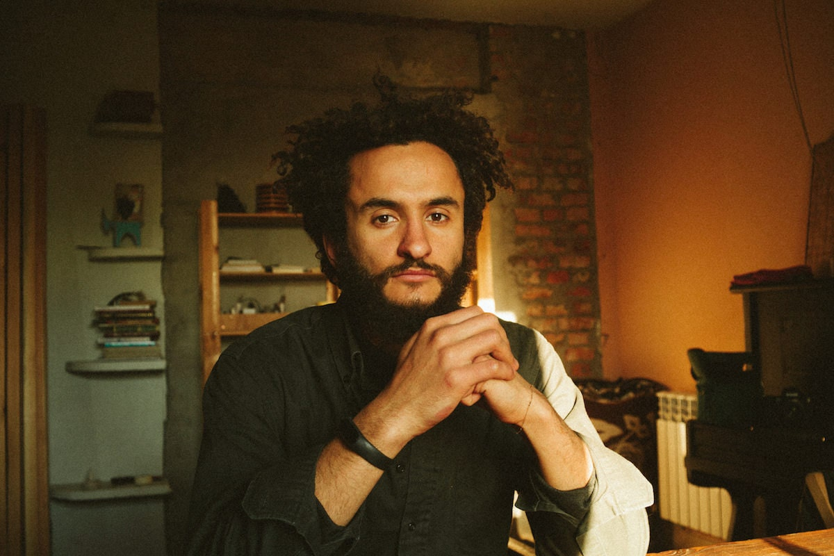 Portrait of Belaya Hvoya proprietor Kirill Babii in his studio