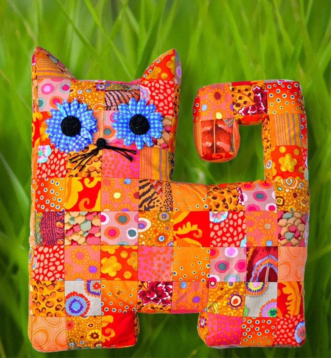 A quilted cat pillow pattern from Etsy