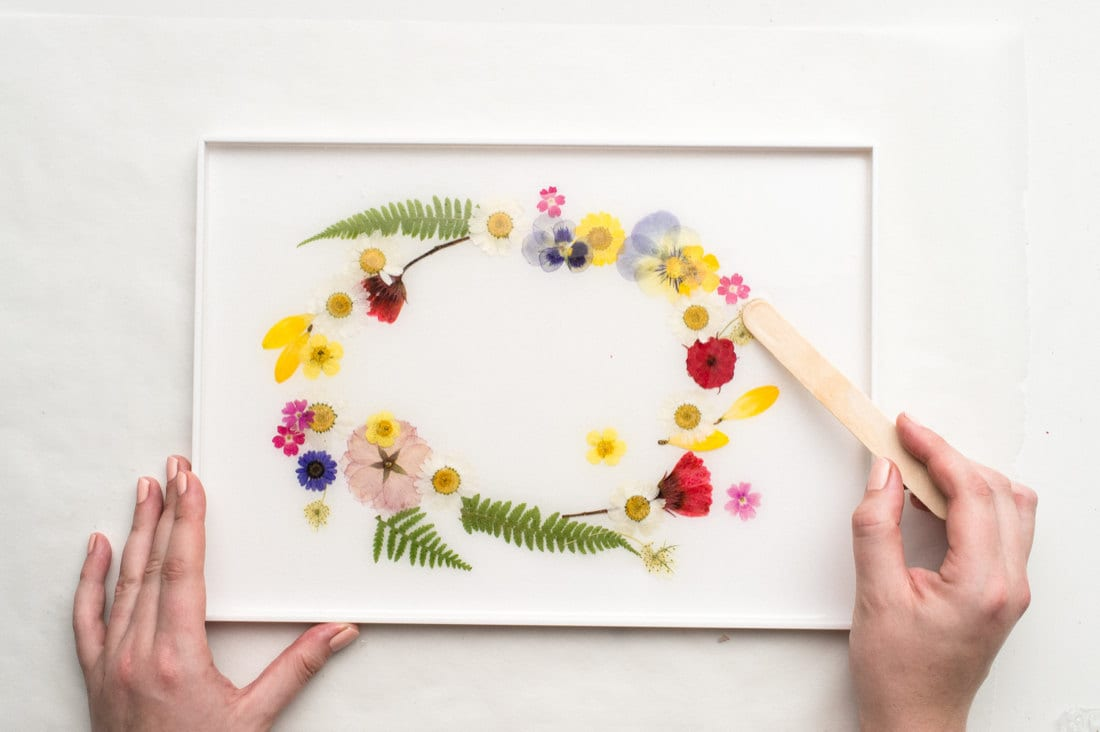 Making small last-minute floral rearrangements with a wood stick