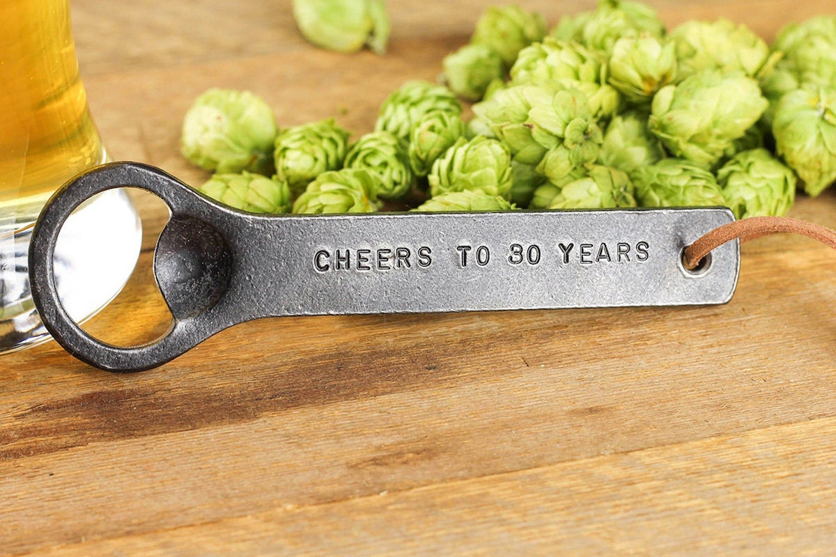 Personalized hand-forged bottle opener from Black Dog Iron Works, on Etsy