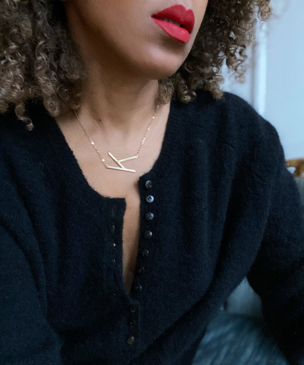 Karen models an oversized initial pendant necklace from Jewelry Blues