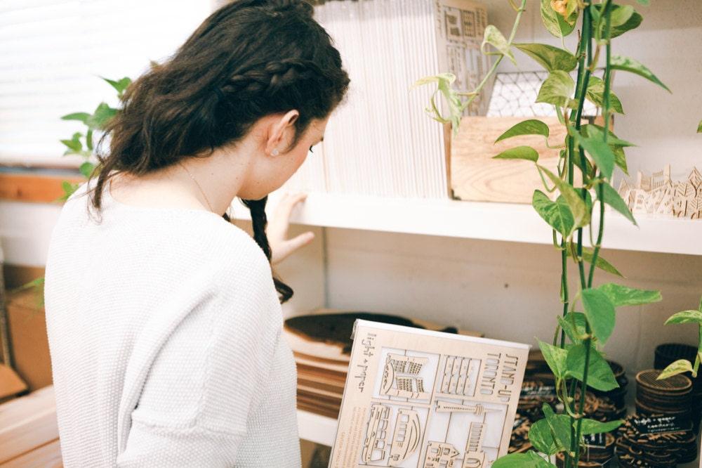 Ali sorting items in her studio.