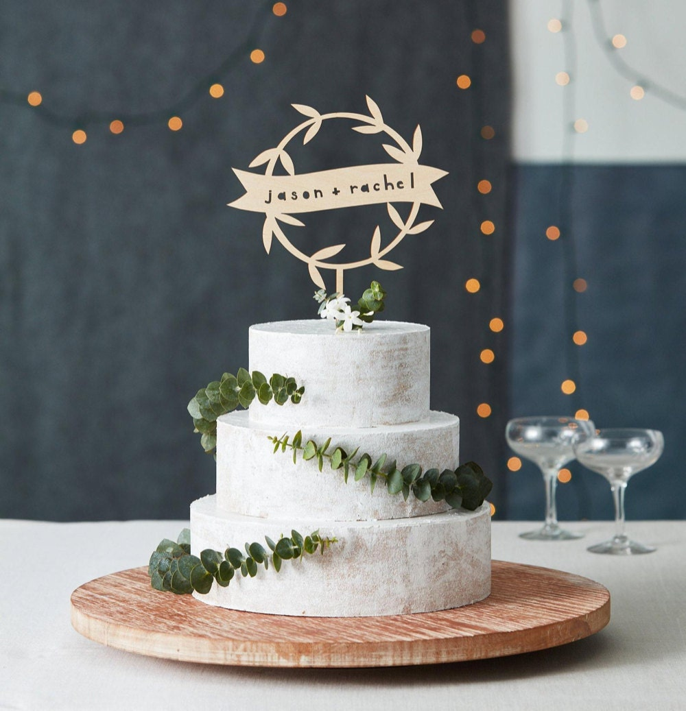 Personalized floral garland wedding cake topper from Light + Paper