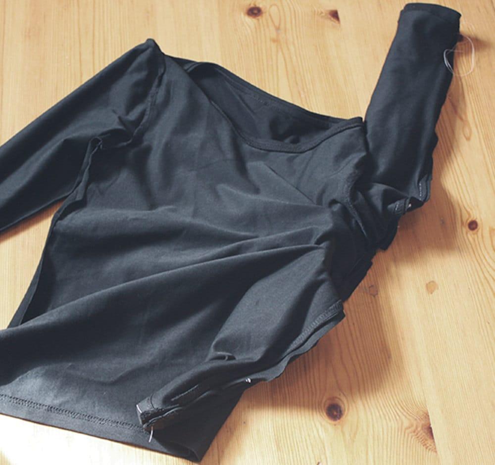 Preparing to add the arm of a DIY bat costume