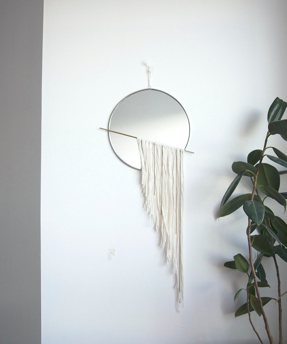 A circle mirror with white fringe from Szklo Glass