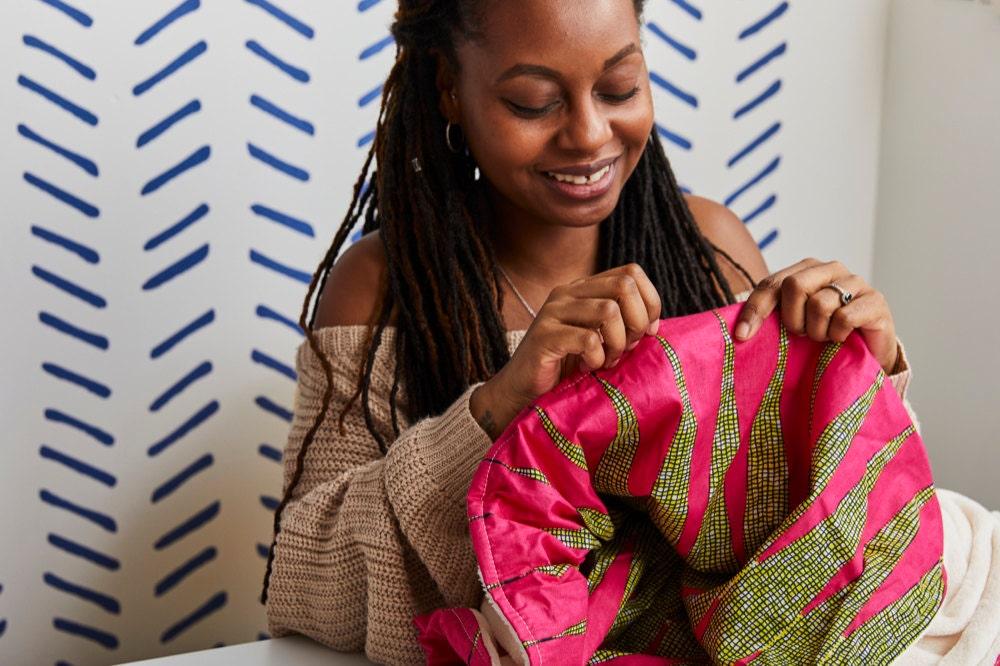 Natalie hand-sews a popular Africa-wax print blanket