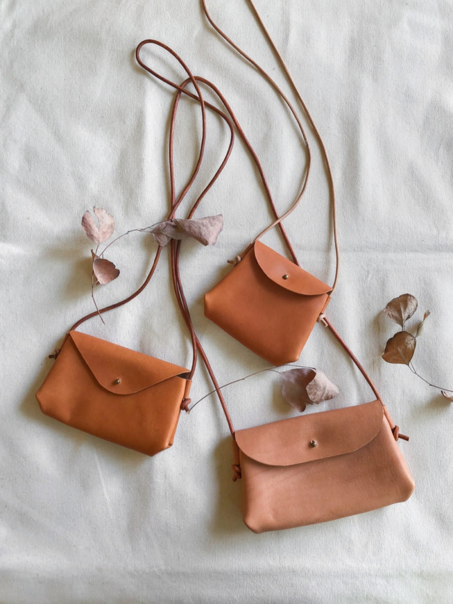 Assorted leather handbags from Small Queue