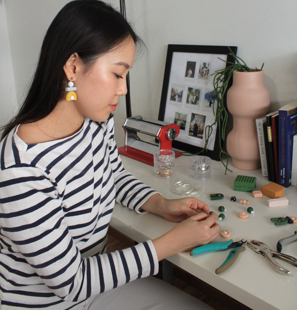 Jessica making jewelry at her desk.