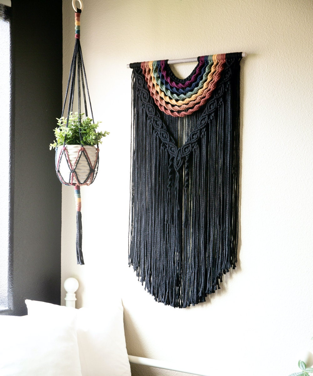A large, colorful fringed wall hanging from Sweet Home Alberti