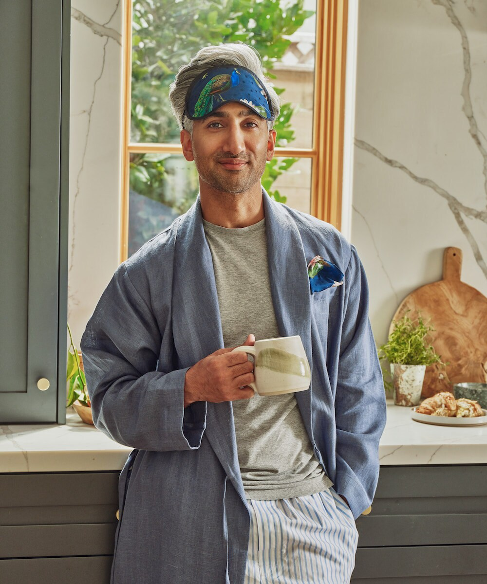 Tan models a linen robe and coordinated pocket square and eye mask from the Tan France x Etsy collection