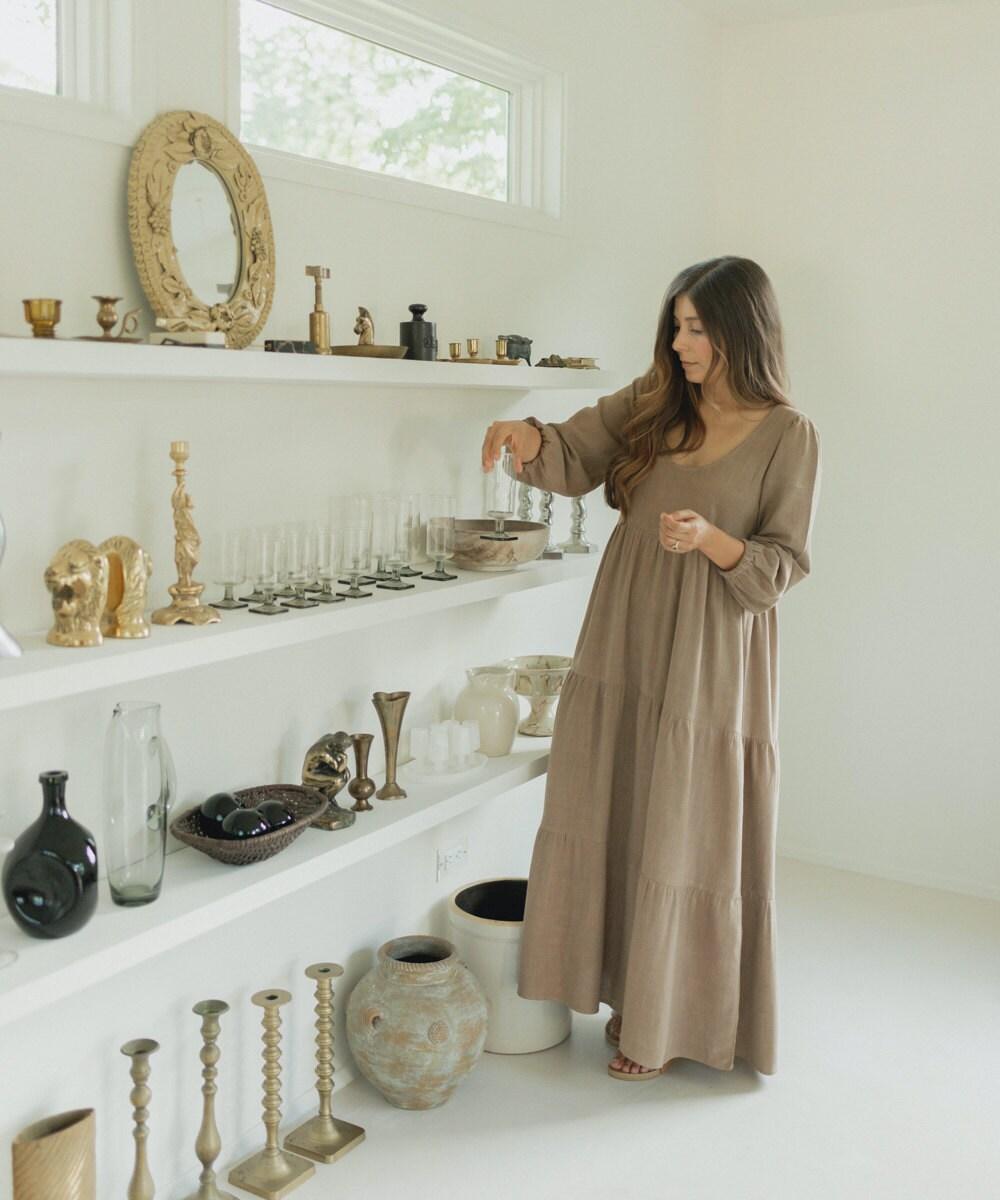 Vintage seller Mara Caballero organizes her stock.