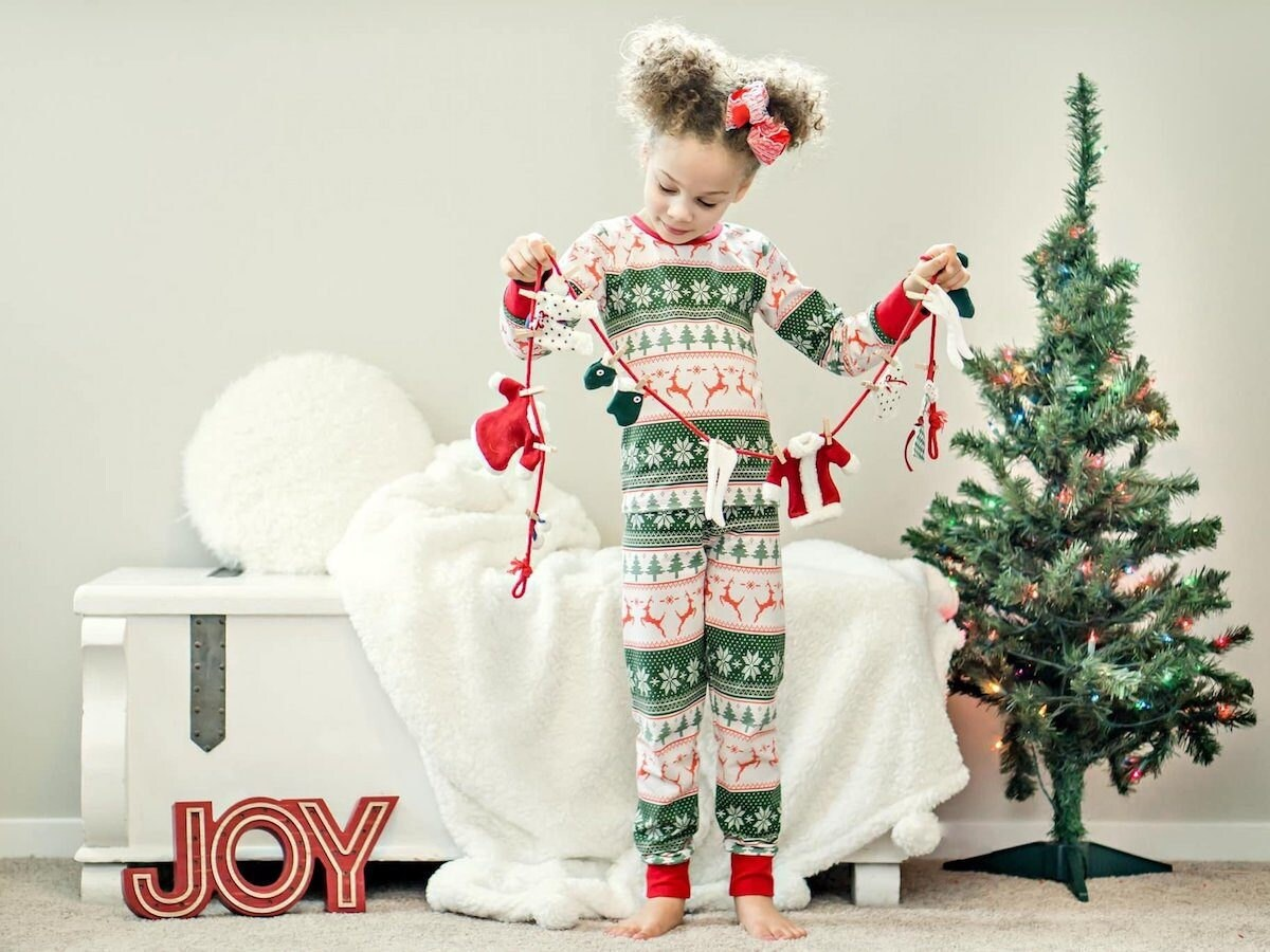 Child wearing festive pajamas from Freckles and Fancy