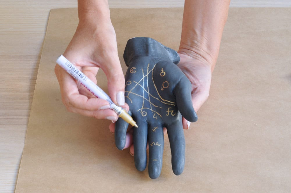 Decorating the painted plaster hand