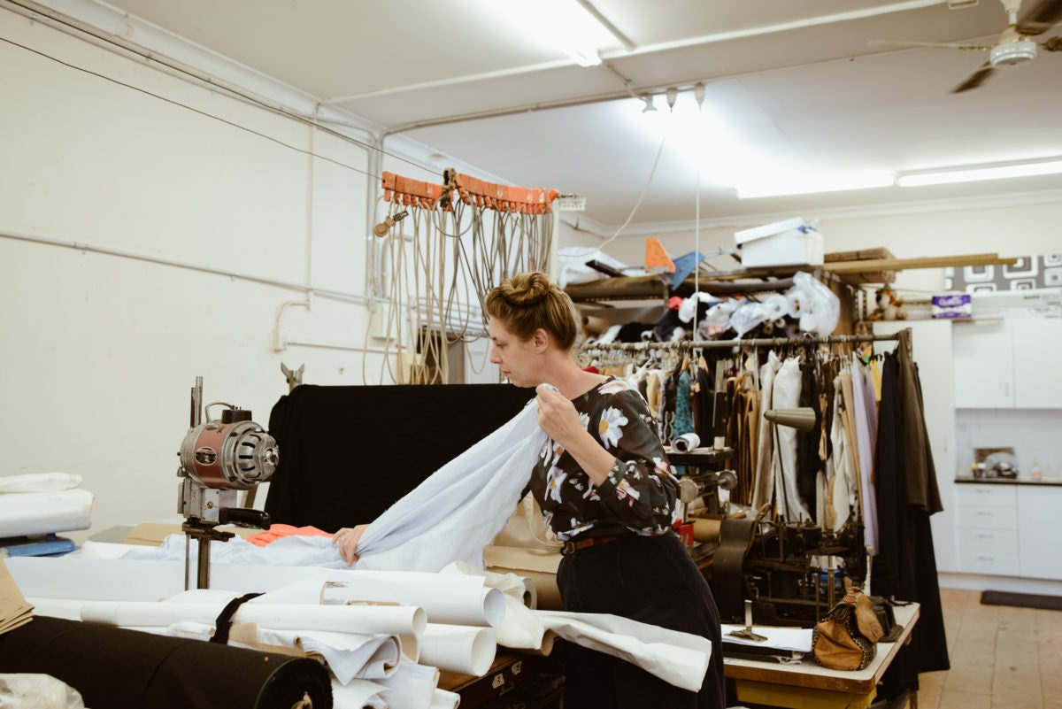 Rabia inspecting new fabric arrivals