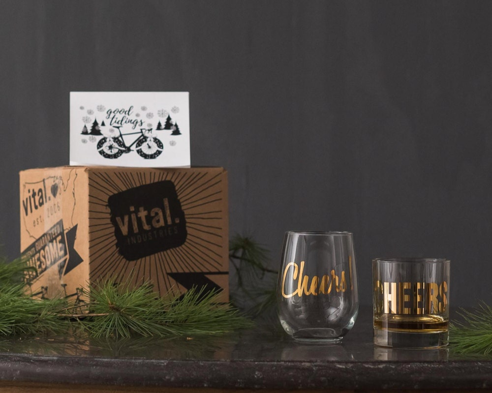 """A his and hers """"Cheers"""" glasses gift set from Vital Industries."""