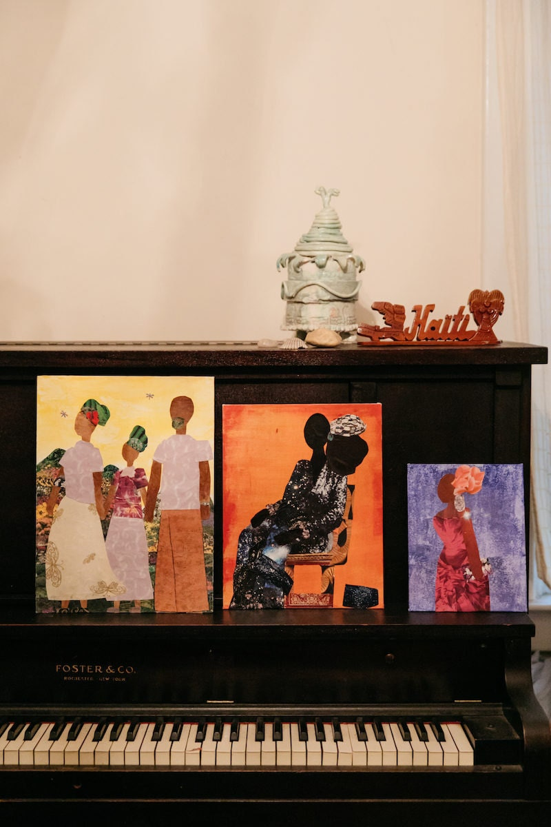 Three collages arranged on a piano in Mirlande's home