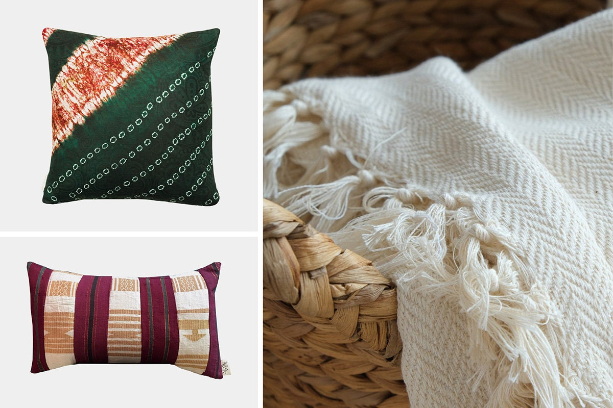 Two patterned pillows and a white cotton throw blanket