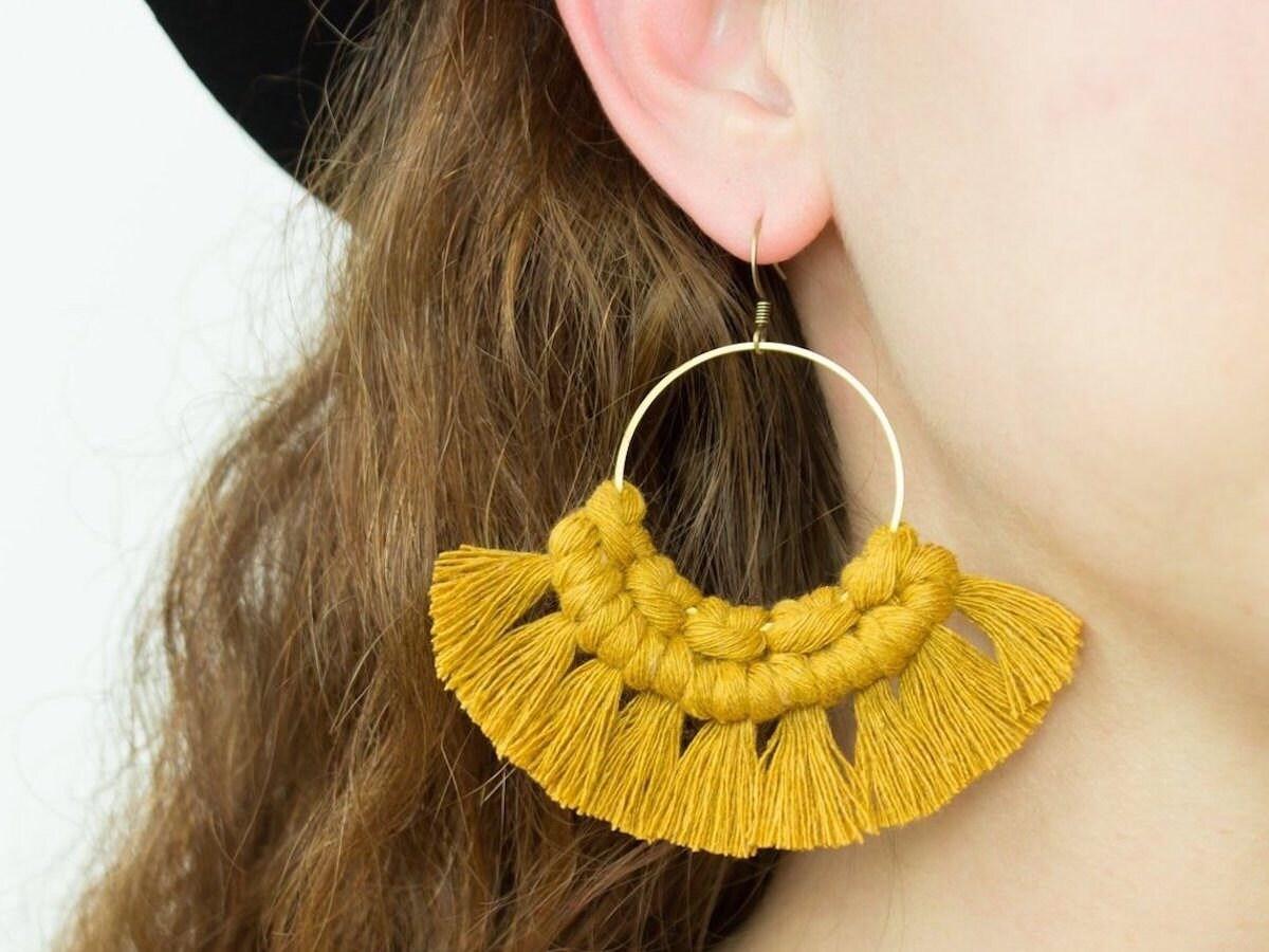 Mustard-colored macrame statement earrings