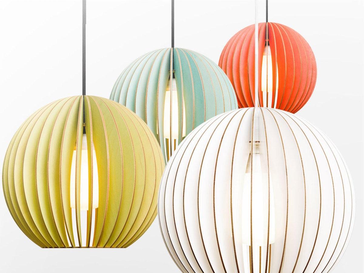 Colorful birchwood pendant lights from Iumi