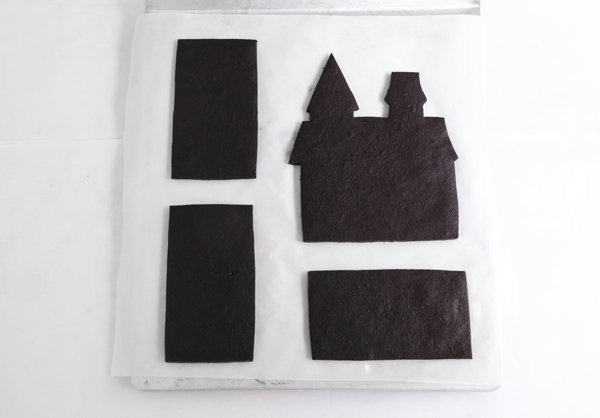 Cutouts of the various castle cookie elements, ready to be assembled and decorated.