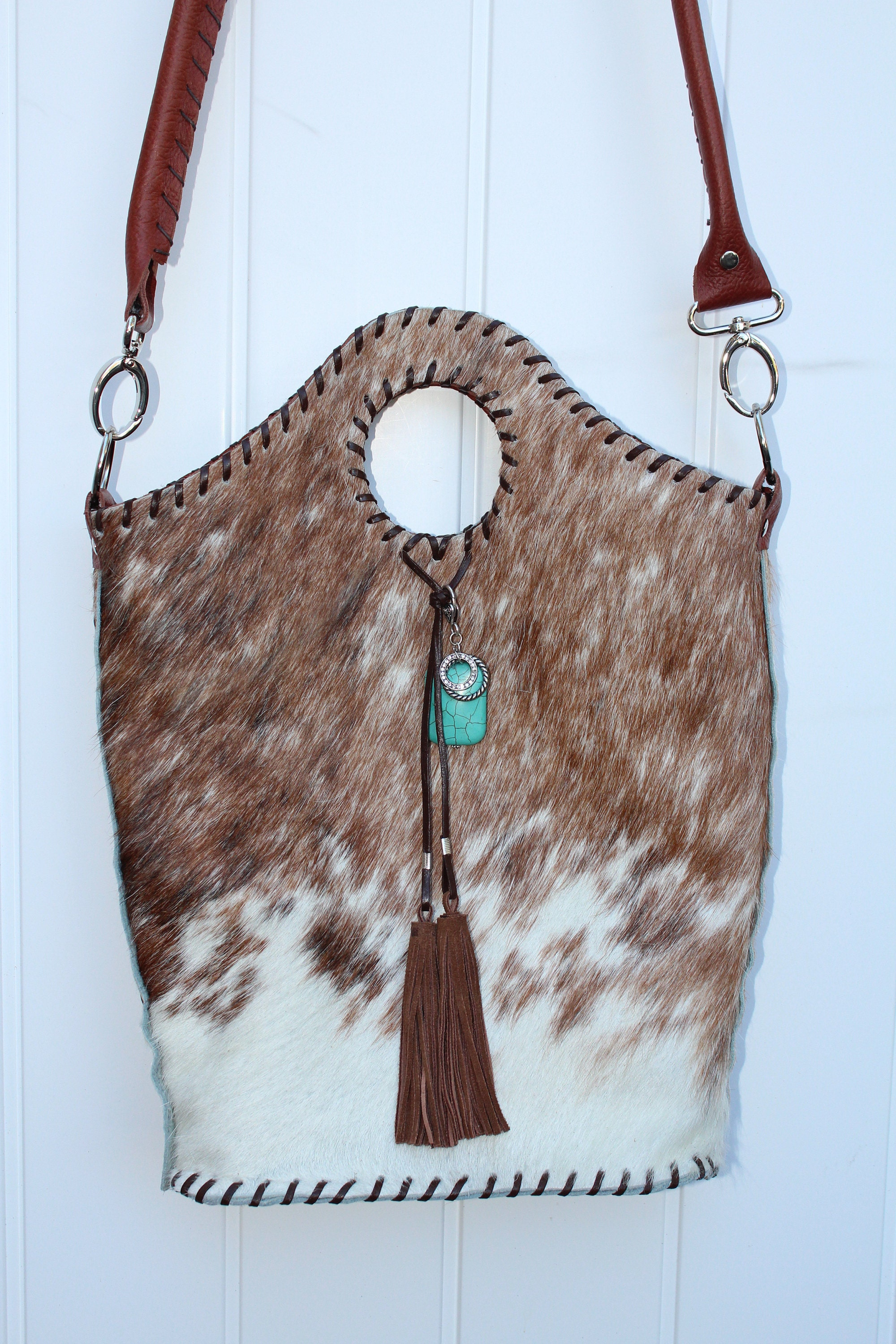 295911d8a Reddish Brown Exotic cowhide Rodeo bag Designed by Stephany Miller