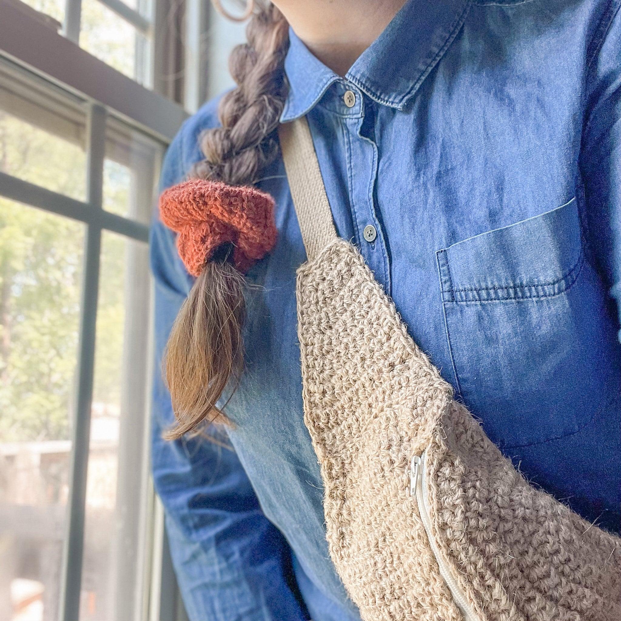 Woman wearing crochet bag and scrunchie