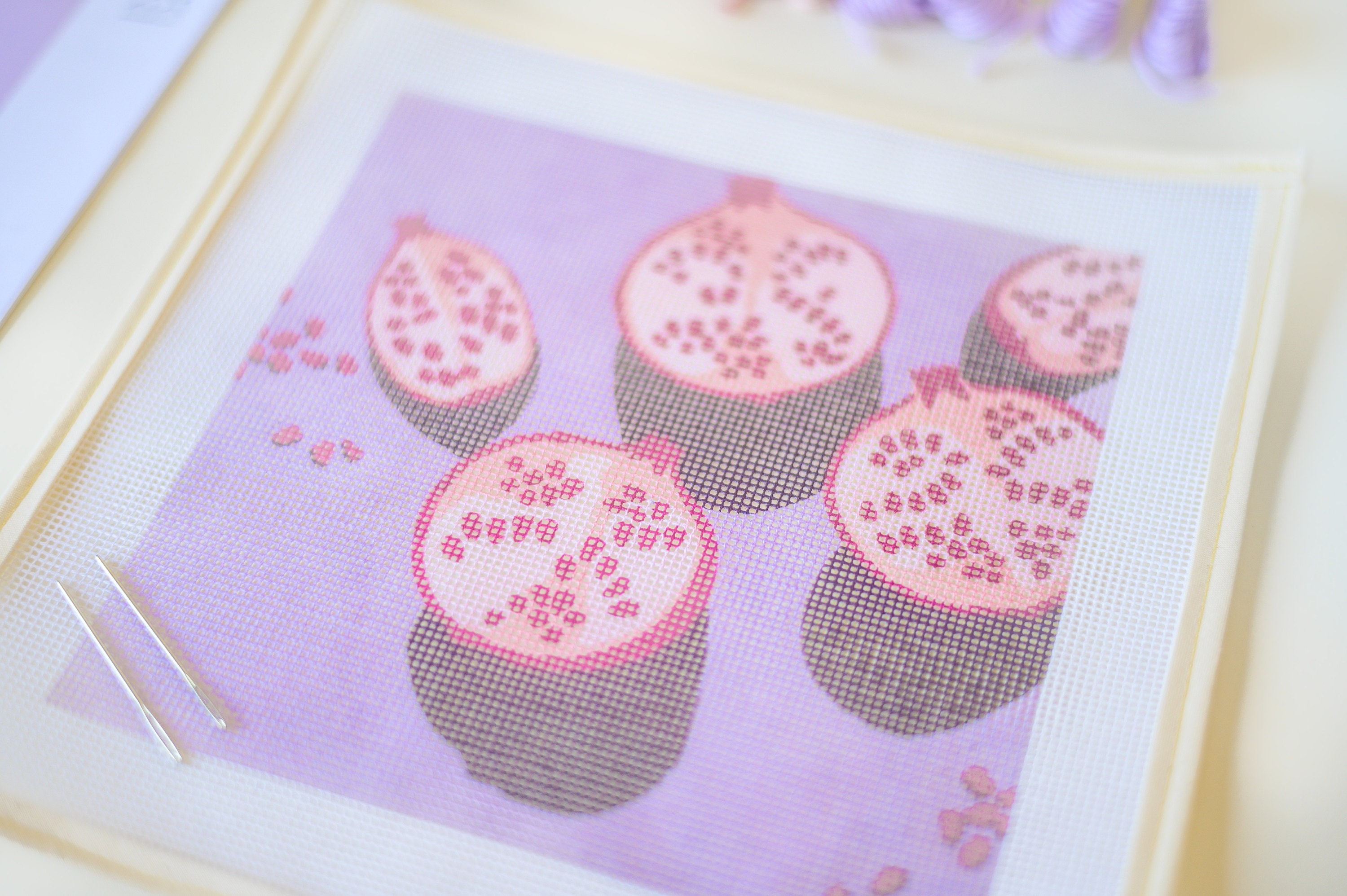 Lilac and pink pomegranate printed needlepoint canvas from Unwind Studio designed by Laura Croft