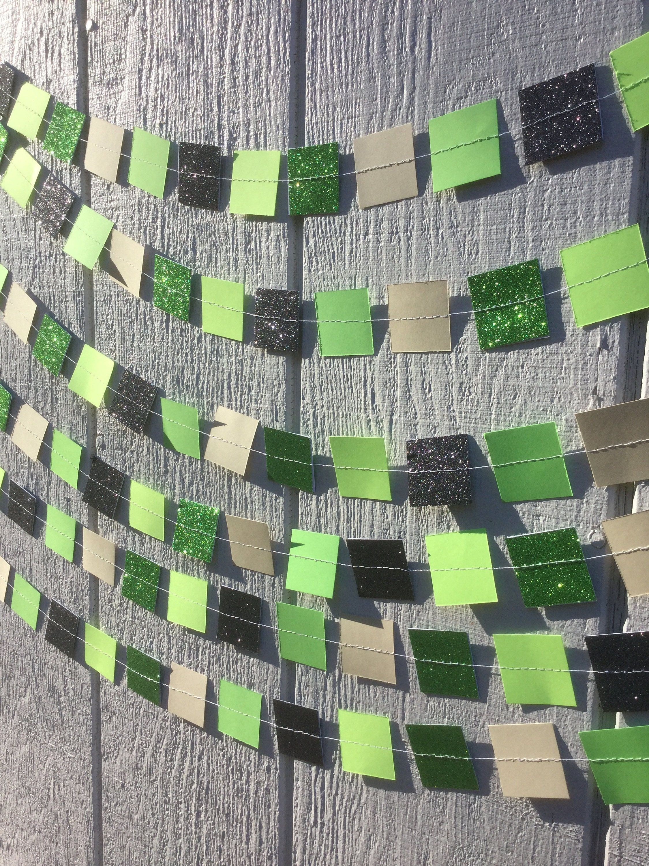 green and black glitter and green and brown paper squares sewn into a Minecraft garland