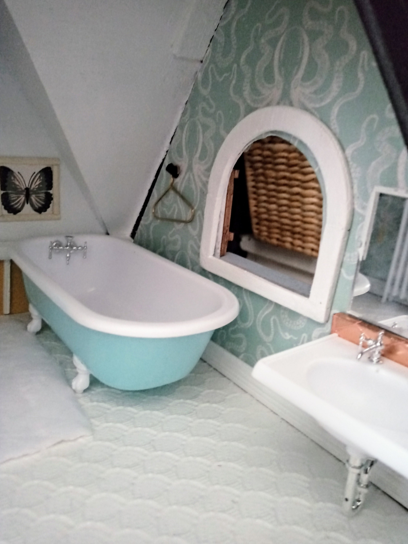 Upstairs Bathroom octopus wallpaper and clawfoot tub