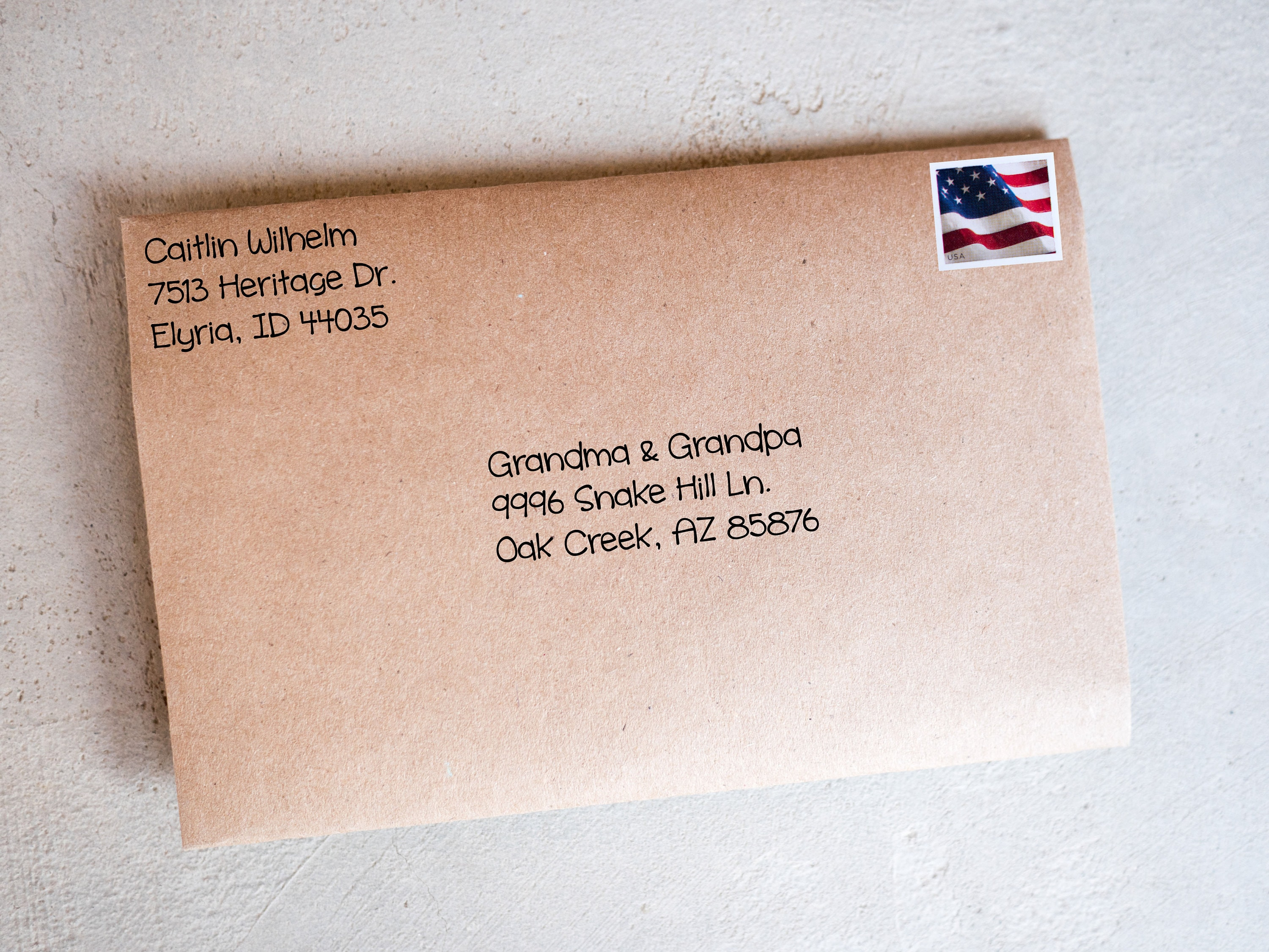 Address the envelope and apply postage