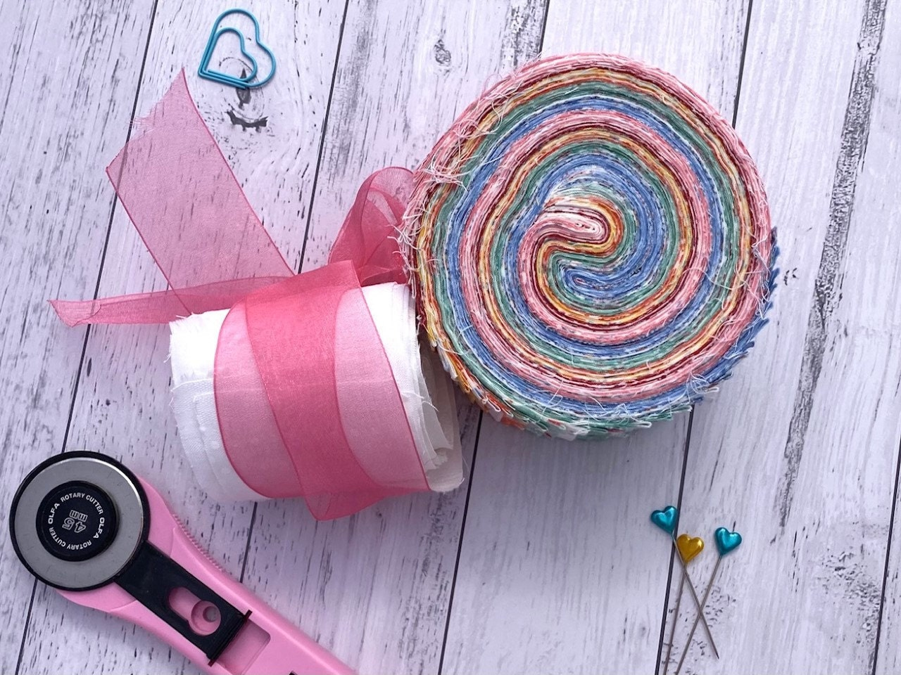 Rotary Cutter and Pretty Jelly Rolls ready to be washed and quilted