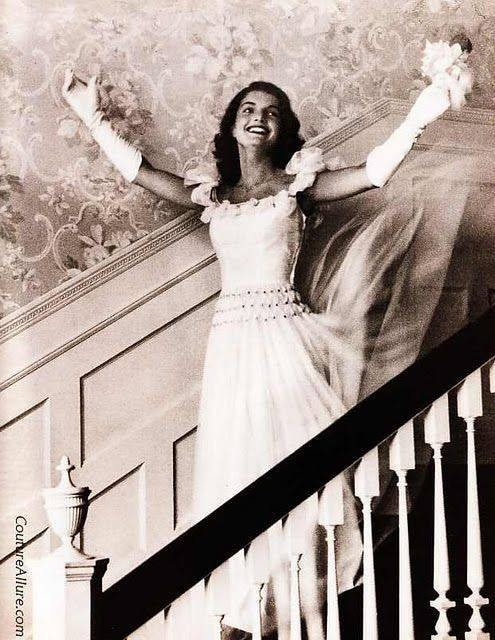 DEBUTANTE OF THE YEAR 1947  Do you recognize her? Its Jacqueline Bouvier wearing a $59 off-the-rack dress in 1947. In 6 years, she would be the wife of Senator John F. Kennedy; and in another 7, she would be First Lady. Do you think she had any idea of what was to come behind that smile?  Note: Jackie is 18 years old in this photo.  (Info courtesy of Couture Allure Vintage Fashion Blog)