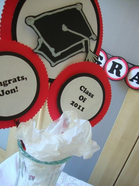 red and black graduation centerpiece with graduation cap