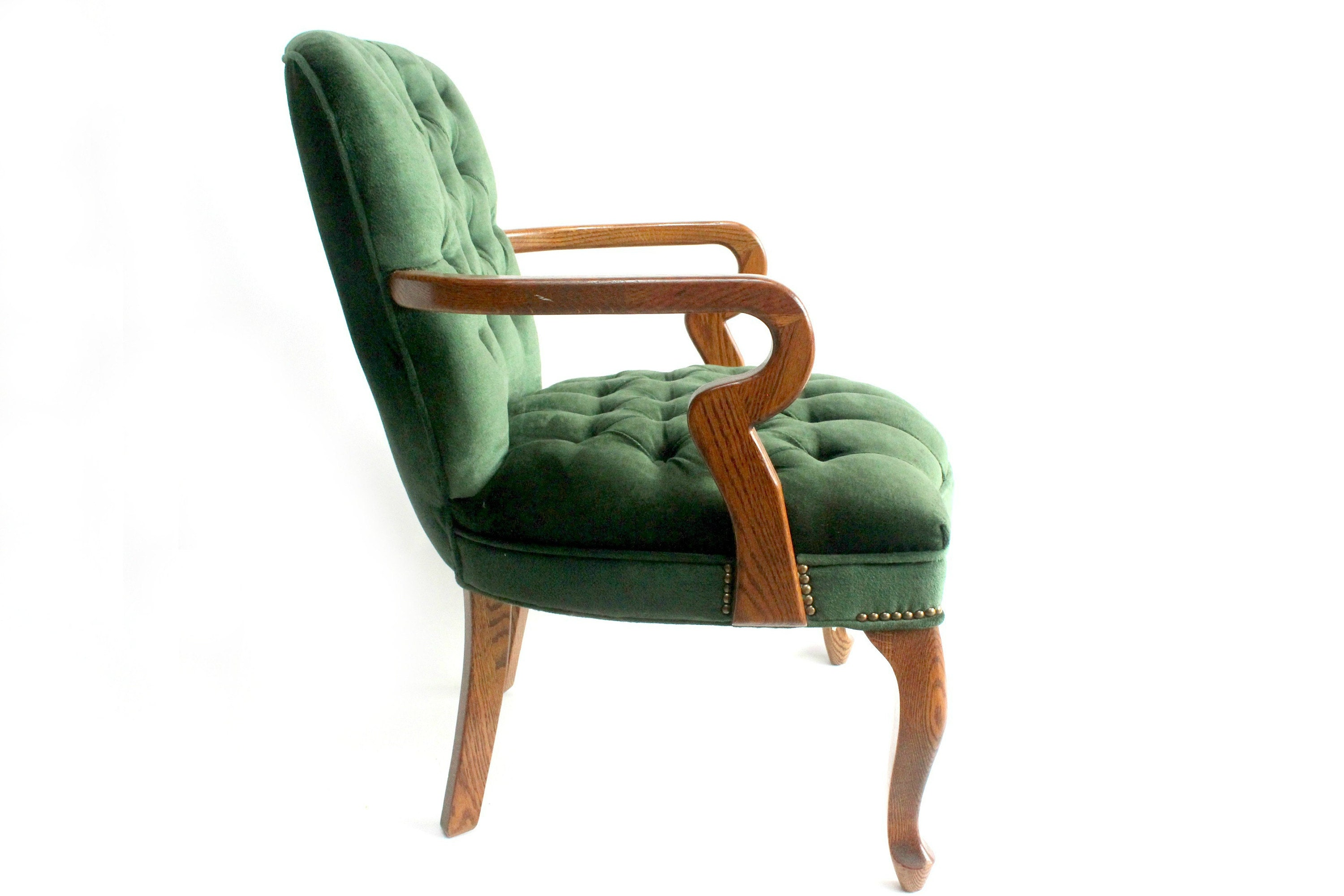 tufted green club chair